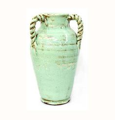 Blue Ceramic Decorative Vase 21st Century Gorgeous large aqua blue ceramic vase with twisted rope handles. This large vase in a stunning aqua blue color functions as a superb decorative piece in any home.