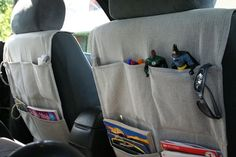 """The car organizer. I love mine! When I posted about them, several of you asked for a tutorial, and these might be a great holiday gift. So sneak into your sister's minivan and take a few measurements. Or make one for your husband's car to hold those Manly-Man Necessities like his tape measure and small tool kit. Hey, wait- I have both of those in my car too... The things you'll need: medium weight fabric, coordinating thread, a sewing machine, a piece of 3/4"""" elastic about 30 inches ..."""