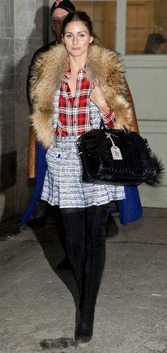 Olivia Palermo accessorizes her purses with chic keychains.