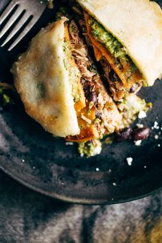 Arepas - fried cornmeal pockets stuffed with all the fillings you could ever want, like carnitas, spicy chicken, sweet potatoes, black beans, sauces, and more. THESE ARE SO GOOD! | pinchofyum.com
