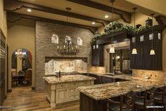 Mediterranean Kitchen with Chandelier, Custom hood, High ceiling, Raised panel, U-shaped, Glass panel, Hardwood floors