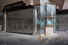 Smashed display cabinets at a jewllers and stained floors are in Rolling Acres mall...