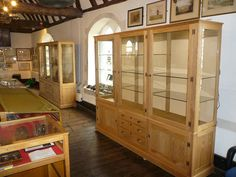 Museum Cabinets, Winchelsea, East Sussex, by SBT Design - Cabinet Makers using American white oak. 2 x Cabinets designed to display artefacts for local museum in Winchelsea. The timber was selected for it's light colour and even grain to compliment and set off the ancient items on display without detracting from them.