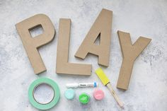 How to Make Colorful Wall Letters - Skip the expensive ones at the store! It's so easy and inexpensive to make your own wall letters! Metal Bird Wall Art, Metal Wall Decor, Playroom Wall Decor, Playroom Ideas, Diy Letters, Cardboard Letters, Reading Corner Kids, Scrabble Tile Wall Art, Roman Clock