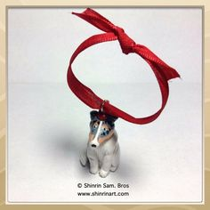 These are handmade, hand painted, one of a kind holiday ornaments that can be a Rough Collie, Smooth Collie or a Sheltie. They are handmade out of polymer clay, hand painted with acrylic paints, glaze