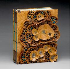 """Tide Pool Book"" 13""h x 10""w x 2""d. Afzelia Burl with inlayed fossil ammonites. Binding by Kathy Doolittle. Bernard Wolf, photography."