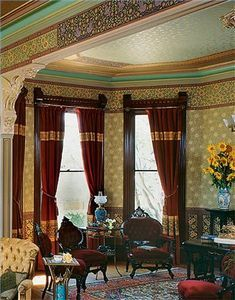 """While we might think of a Victorian room as """"crowded"""" or """"busy,"""" the Victorians were believers in the adage, """"If you've got it, flaunt it."""" This meant that every photograph, every painting, every decorative gift, every pipe, pipe rack, throw, occasional chair, occasional table and occasional pillow was displayed for all the world to see. Decorating in the Victorian manner can be as posh as you please or strike a balance between the historically correct and modern tastes."""