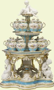 Dessert stand  The Royal Collection © 2012,  Her Majesty Queen Elizabeth II  RCIN 59767.1  Dessert stand    1850-1    Minton & Co, manufacturer; Pierre-Emile Jeannest, designer and modeller    Purchased by Queen Victoria