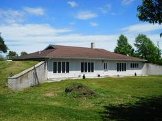 Bring your Horses to this 3 BR/2 Bath Berm Home just West of Aurora on 13 Acres. Spacious Open Kitchen w/Dave's Custom Cabinets and Living Room Featuring a Buck Stove W/Marble Surround. Nice sized Bedroom. All Electric Home w/Newer Heat Pump, Roof, Guttering, trim around windows & Water Softener. 40 x 40 Horse Barn w/Tack Room and 3 Stalls. Heated Stock Waterer and lots of Metal Pipe Fencing. Home also has City Water, Motor Home Carport & Additional Hay/Implement Barn in Verona MO