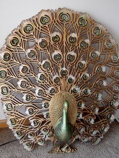 @ Peacock Passion: Vintage #peacock gold green fireplace screen. Francene Perel. --  crystal, look familiar?  Same as yours!