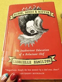 Blood, Bones & Butter: The Inadvertant Education of a Reluctant Chef by Gabrielle Hamilton is quite a fun memoir if anyone is looking for summer reading material