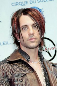Short Straight Black Hair with Red Highlights and Sharp Feathered Strands,  Chris Angel