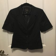 Short Sleeve Jacket Black short sleeve jacket from The Limited Collection. Outer Shell: 98% cotton, 2% spandex; Lining: 100% polyester. Dry clean only The Limited Jackets & Coats