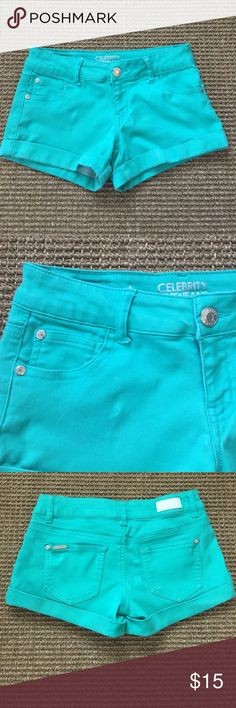 """Celebrity Pink Jeans pool green short shorts. 5 Cute Celebrity Pink Jeans. Fabulous super stretchy, pool green short shorts. 68% cotton, 30% polyester, 2% spandex fabric. Waist 26"""", front length 9"""", back 10.5"""", inseam 2.5"""". The color is a little dark tone that is in the pictures. Great condition Celebrity Pink Shorts Skorts"""