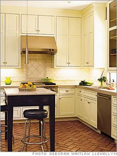 This layout is just like mine, and proves to me that an island doesn't have to be made of cabinetry to be beautiful.