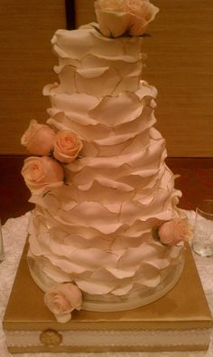 Petal cake w/ custom cake stand, gold rimmed petals cover this golden anniversary cake.