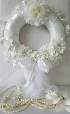 Check out this item in my Etsy shop https://www.etsy.com/uk/listing/245641830/white-fabric-and-satin-bridal-wreath