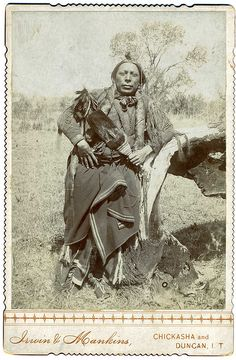An American-Indian Posing Outdoors, Indian Territory, Oklahoma, via Flickr.