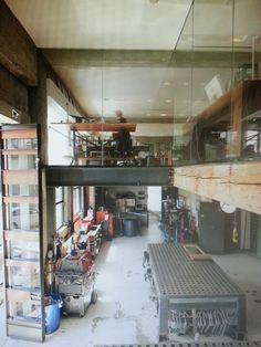 Main floor metal work shop w/living on 2 nd floor. Note steel ceiling beam and door.