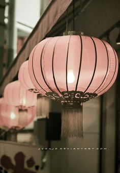 These light pink lanterns add a soft touch of light to the space.