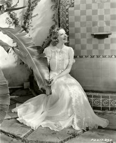 Actress Franciska Gaal, 1930s,  wearing long white dress with pretty ruffle details. From myvintagevogue.com