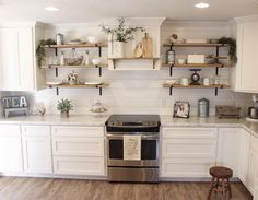 I love this farmhouse kitchen with the open shelving and ship lap backsplash. See this Instagram photo by @our_blessed_nest •