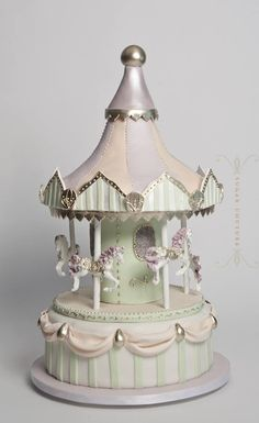 Cute carousel cake, lovely for birthdays and weddings