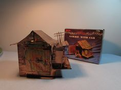 Copper Art Car in Garage Music Box with original box.  Car revolves around and in and out of the garage while it Plays King of the Road by BeanzVintiques on Etsy