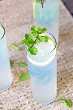 Blue raspberry lemonade cocktails are perfect for those long summer evenings spent sitting on the veranda. #cocktail