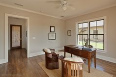 """How to size interior trim: door trim 50% of base boards.  Or doubling the door trim size would mean our baseboards should be about 5"""".  Sounds about right for how short our walls are!!    eclectic home office by Redbud Custom Homes"""