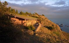 I love how this coastal home just blends into a cliff face on Lopez Island