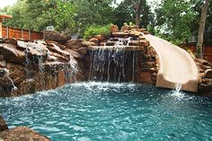 slide into the pool and waterfall off the rocks, would love to have a grotto underneath the waterfall/ slide