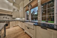 820 Eagle Pointe Montgomery, TX 77316: Photo Large kitchen windows allow lots of natural light, professional grade appliances, 2 dishwashers and built in refrigerator.