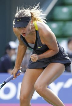 Maria Sharapova... I have this dress, just wished I played like her in it.