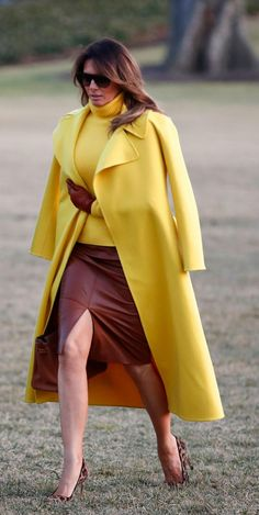 7a6393da First lady Melania Trump walks from Marine One to the White House in  Washington as she