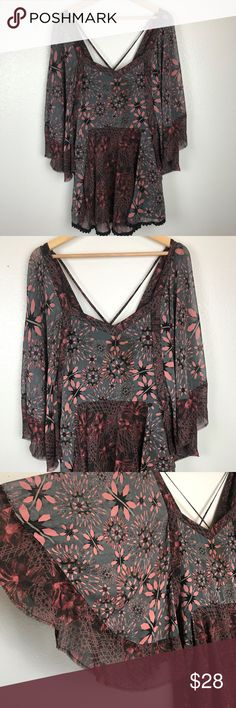 "Free People Boho Tunic Top Sheer Floral Print Name Brand: Free People Boho Tunic Top, Sheer Floral Print Gray Black Burgandy Crochet Hem Sz XS.  Batwing sleeves with distressed hem.  Condition: Pre-Owned Very Good Condition, no holes, stains or flaws to note (see photos for condition detail)  Size: XS   Color: Burgundy Black Gray    Style: Boho Top  Material: 100% Polyester Always check the measurements, label sizes are not consistent. Bust: 16"" Sleeve: 19.5"" Waist: 16 Length: 20"" (front…"