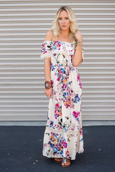 Made to turn heads this Off The Shoulder Floral Ivory Maxi Dress will keep…