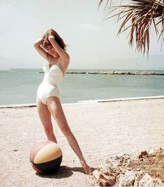 @Who What Wear - The swimsuit, the beach ball, the hair — enough said. Year: 1955