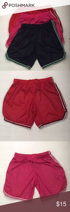 3 Exercising Gym Shorts EUC. Barely worn. Three gym shorts for the price of 1.  Red Short: SIZE MEDIUM Navy Short: SIZE MEDIUM Pink Short: SIZE SMALL  ALL PRACTICALLY FIT LIKE SAME SIZE: SMALL/MEDIUM  WAIST: 14 INCH INSEAM: 8 INCH  Pet-Free & Smoke-Free Home BCG Shorts