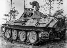 A Panther V Ausf G lost it's  right track and was abandoned, allowing for an inspection from a U.S. intelligence officer