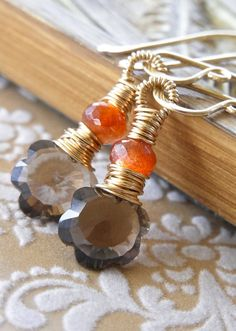 Clivia - petite smoky quartz, sunstone and goldfill earrings. Love the idea of the top bead breaking up the wrap.