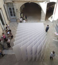 Different views of a courtyard were framed by this temporary installation in Montpellier, France, by Dutch architecture office Paul Scales and French architecture and design studio Atelier Kit