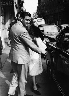 Barbara Hutton, heiress to the Woolworths empire, with her friend, James Douglas, get into their car outside a hotel in Milan, 1959.