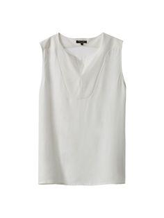 Μπλούζα με σχέδιο ύφανσης. Ίσια γραμμή, στρογγυλή λαιμόκοψη με άνοιγμα, διακοσμητικό άνοιγμα μπροστά και χωρίς μανίκια.