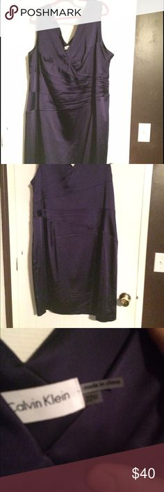 Calvin Klein Stretch Satin Sheath size 22 I only wore this once, to a wedding. I received tons of compliments. It's a dark purple color, very flattering for all shapes (I am an Apple). Length hits about mid thigh. Purchased at Nordstrom. Calvin Klein Dresses Mini