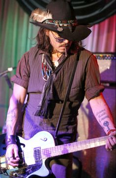 Johnny Depp rocks out playing the guitar with Bill Carter & The LA Blame at The Mint Bar in Los Angeles, CA.
