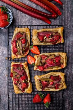 This is a great and delicious recipe for strawberry-rhubarb pastry tarts filled with almond frangipane. You can either make homemade puff pastry or use storebought. It's our mums favorite it's not to overwhelmingly sweet, it's just perfect sweet from the strawberries and tart from the rhubarb. www.twosisterslivinglife.com #strawberryrhubarbtarts #strawberryrhubarbpastry #rhubarbgalettes #starwberryrhubarbpuffpastry #rhubarbrecipes #strawberryrhubarbminipies #springrecipes Unique Recipes, Sweet Recipes, Mixed Berry Pie, Tart Filling, Puff Pastry Recipes, Strawberry Recipes, Spring Recipes, Yummy Food, Delicious Recipes