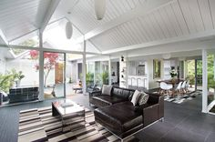 midcentury living room by Klopf Architecture, beautiful central open air courtyard. Front connecting wall is actually just frosted glass. Beautiful.