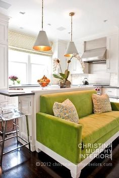 Ok, I am not saying that I want this kitchen, but I love the idea of a cozy place like this to sit right next to the kitchen!  It is where everyone ends up anyway!  Better be a good stain protector on it though!