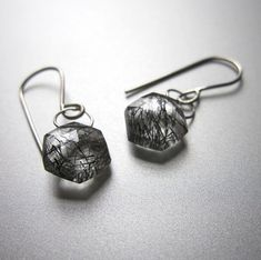 Sparkly drops of graphic rutilated quartz hang from soldered white gold loops and ear wires.